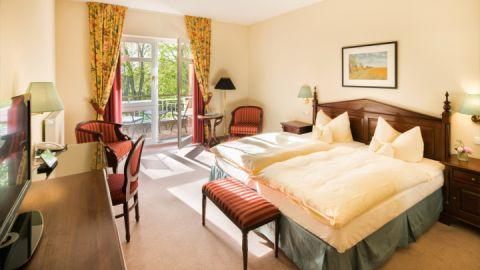 Blick in eines der Zimmer des Hotels Kurhaus am Inselsee